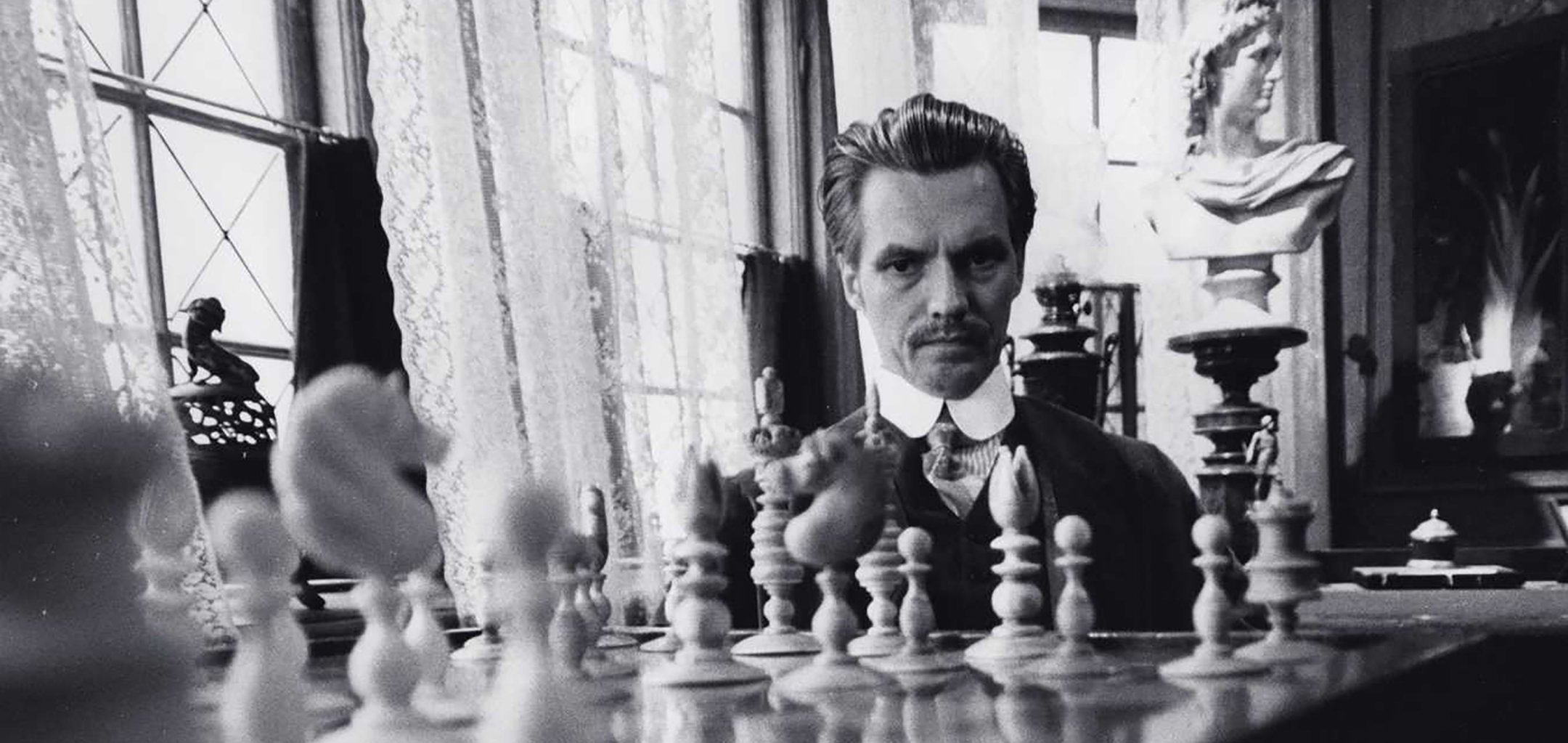 Per Oscarsson as the titluar character of Doctor Glas (1968), staring at a chess board