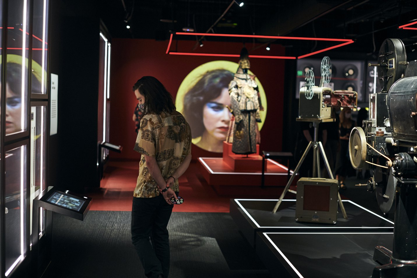 Supercut video visible as circular projection within The Story of the Moving Image - photo by Eugene Hyland