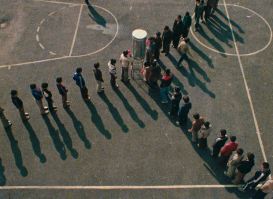 Overhead shot of kids lining up on a school bastketball court in a still from 'Orderly or Disorderly' (1981) (c) Kanoon