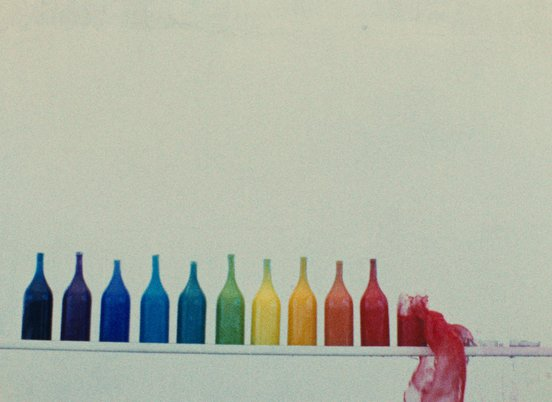 Rainbow arrangement of bottles in a still from 'The Colours' (1976) (c) Kanoon