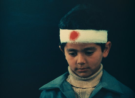 Kid wearing a headband with a red spot on it in a still from 'Two Solutions For One Problem' (1975) (c) Kanoon