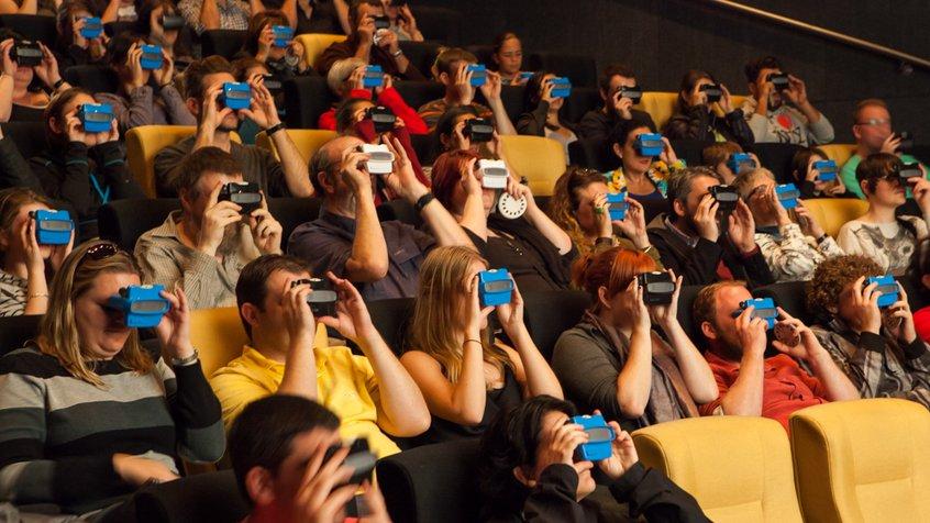 Cinema audiences use viewfinders at ACMI White Night 2014. Image credit: Mark Gambino