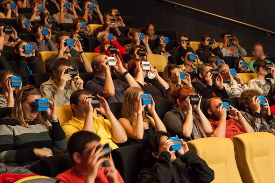 Cinema audiences use viewfinders at ACMI White Night 2014. Image credit: Mark Gambino
