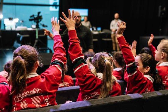 School kids raise their hands in the ACMI Gandel Lab