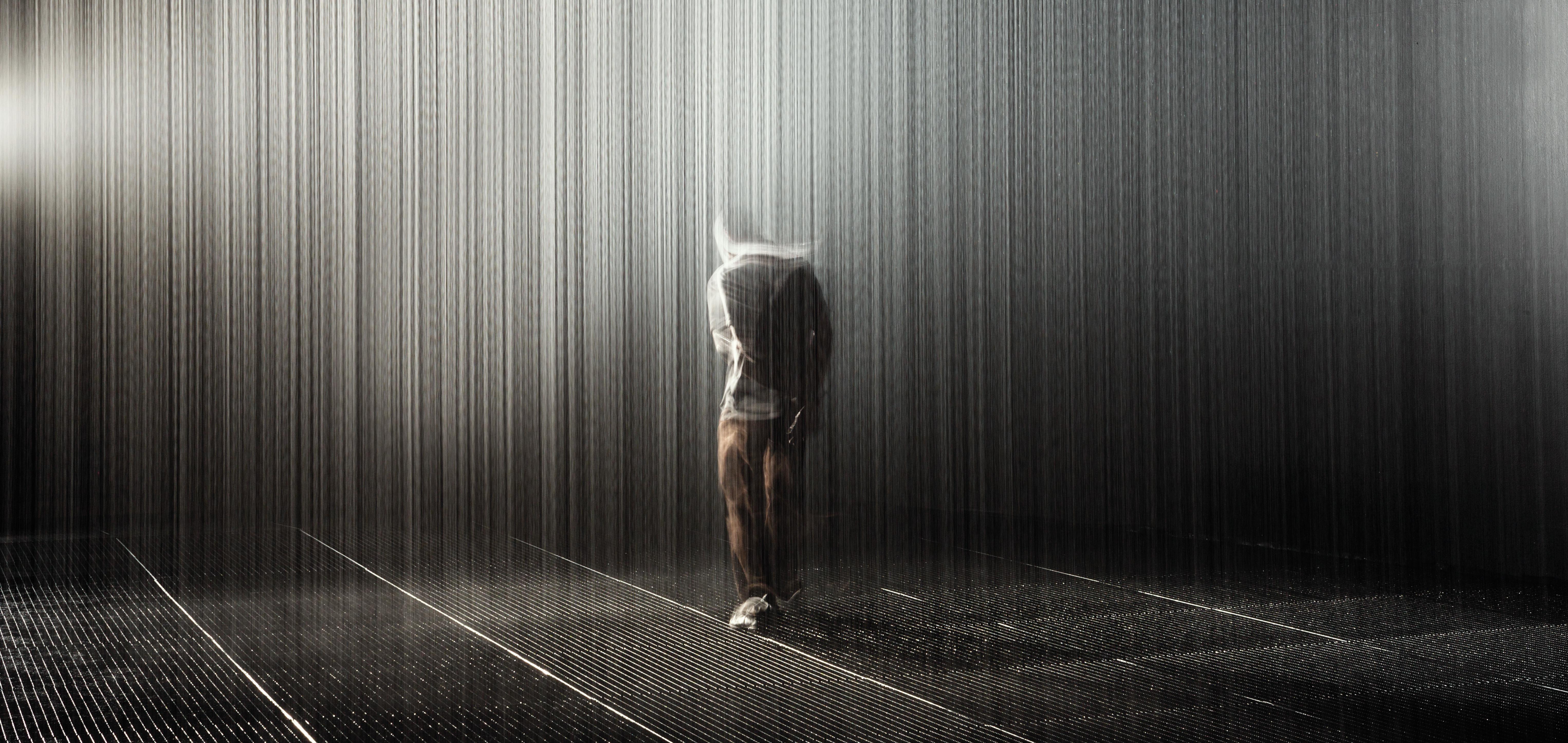 A person experiencing Rain Room -  image courtesy of RANDOM INTERNATIONAL - hero image