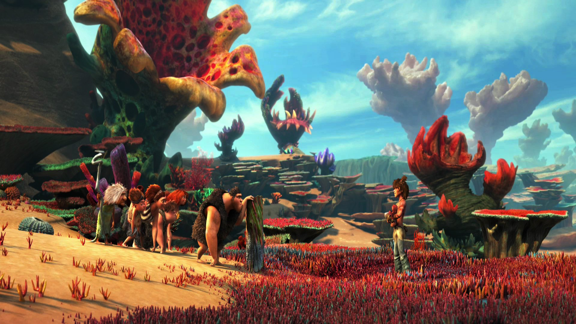 A still from 'The Croods' showing the main cast of characters and the colourful landscape (2013)