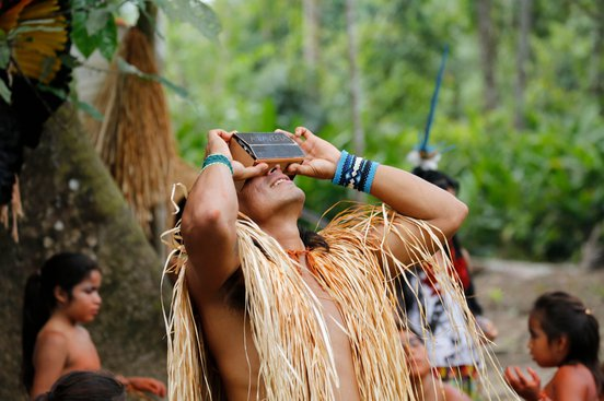 A tribesman of the Yawanawa people of the Amazon tries out VR for Awavena