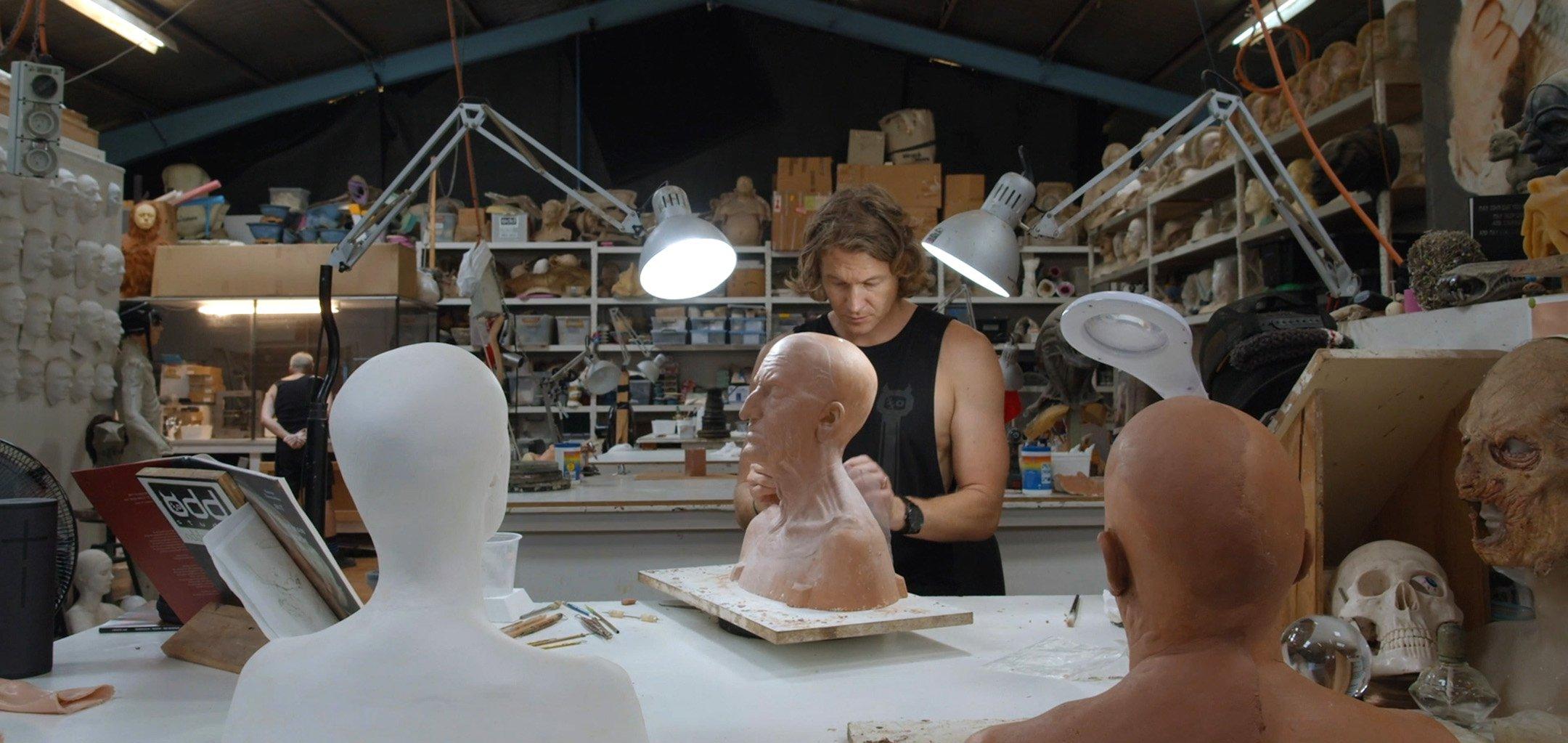 Adam Johanson working on a prosthetic witch head in Odd Studio -  long shot