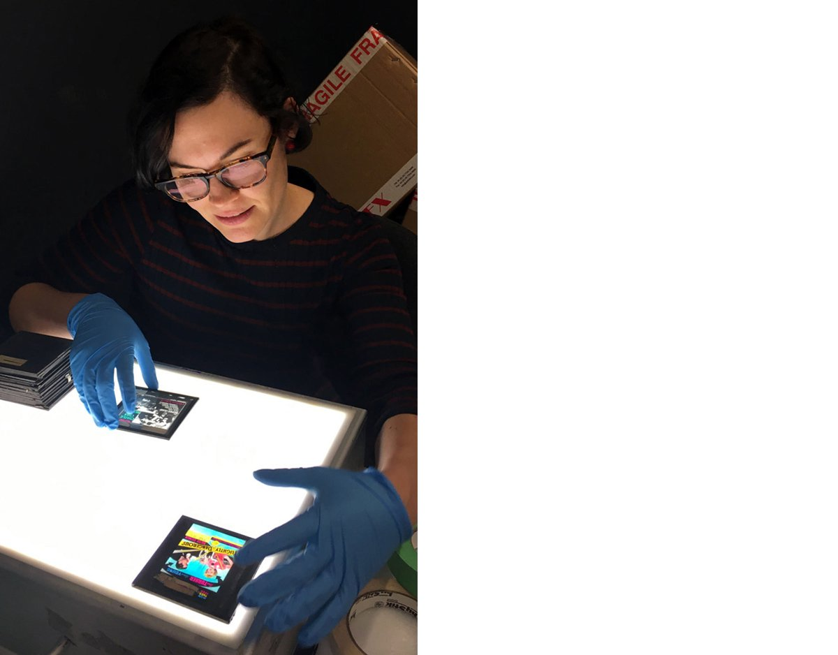 Assistant Curator Chelsey O'Brien examines some of the magic lantern slides from EAFA
