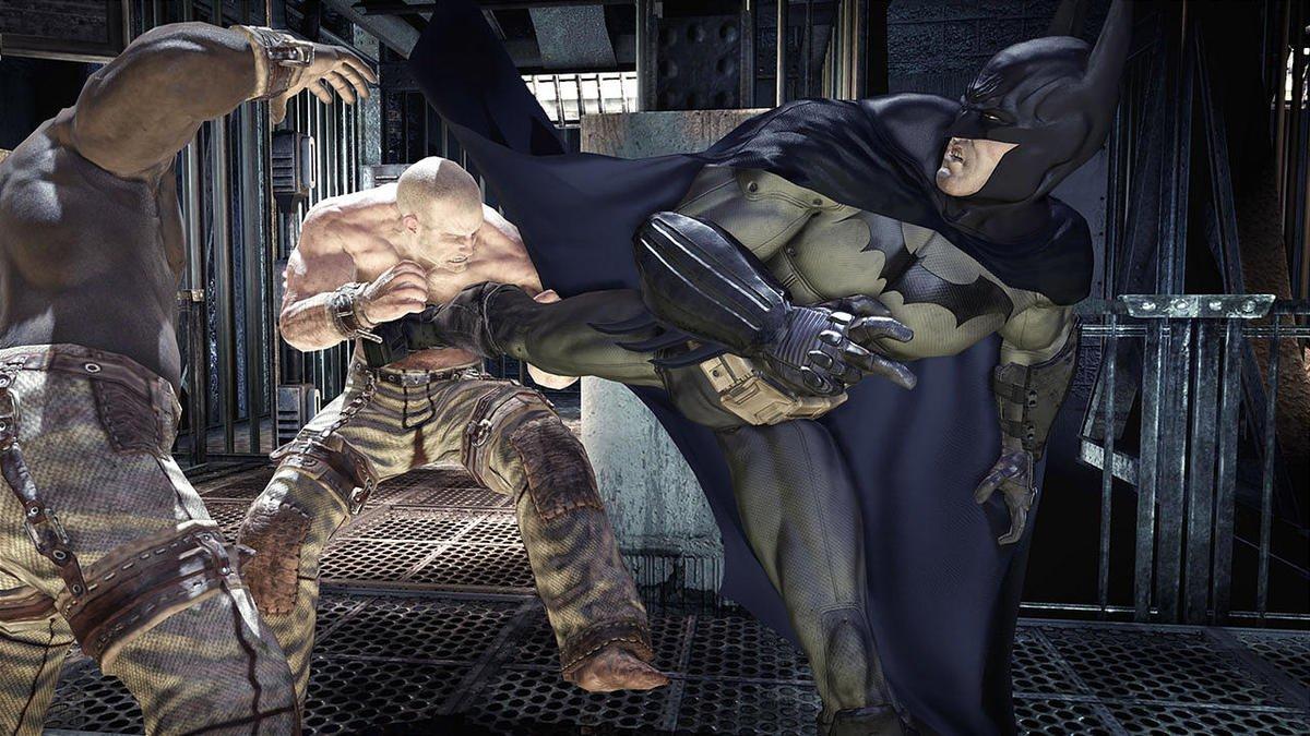 Screenshot from Batman Arkham Asylum (2011) - Batman kicking inmates