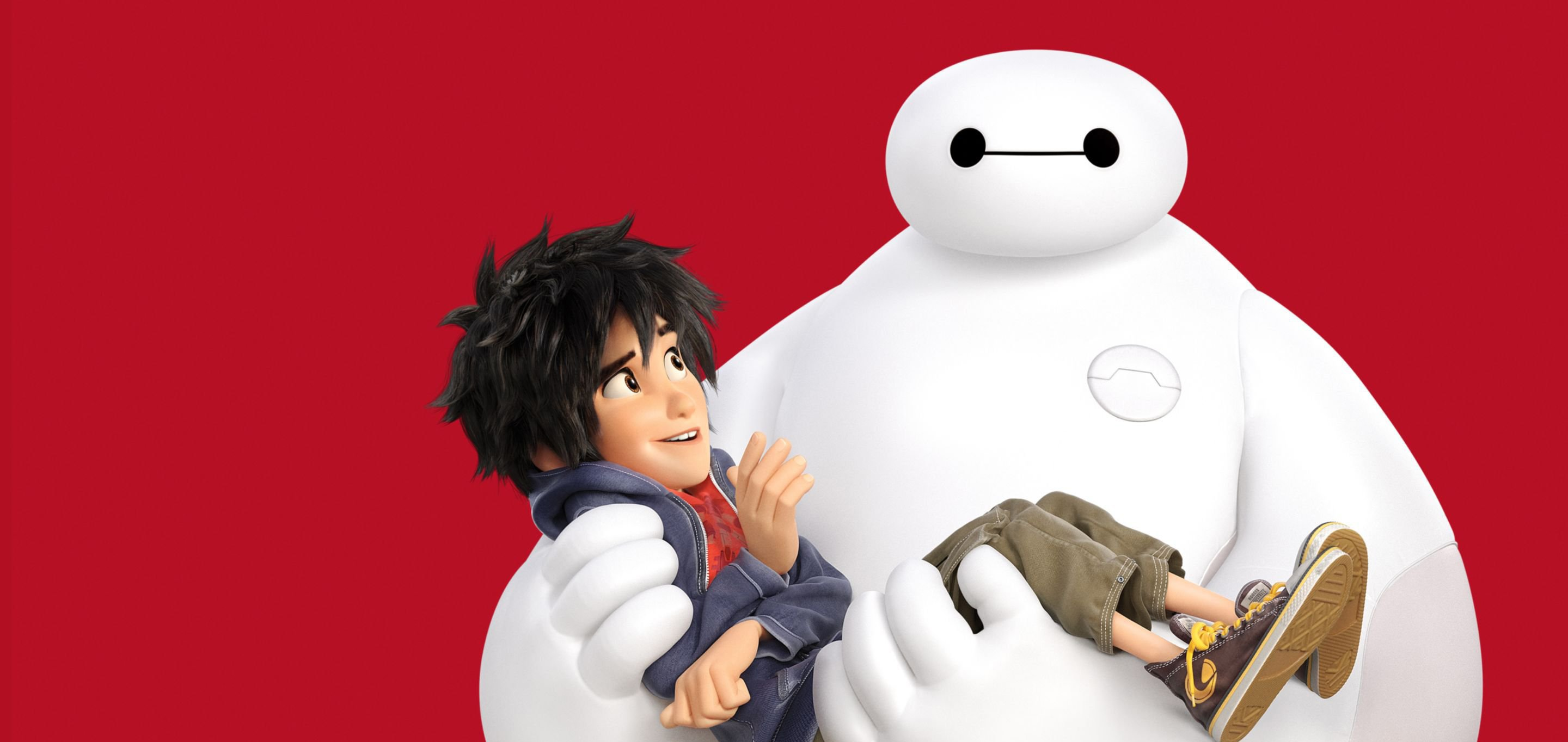 Hiro Hamada being carried by his robot companion Baymax in a publicity still from Disney's 'Big Hero 6' (2014))