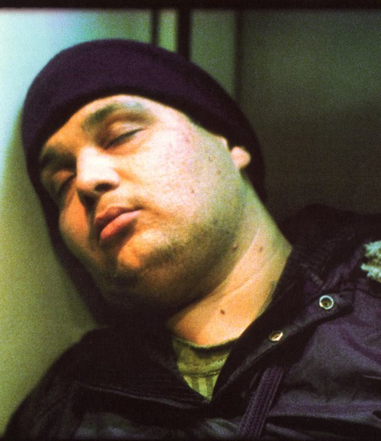 Hossain Emadeddin rests his head against a wall in a still from 'Crimson Gold' (2003)