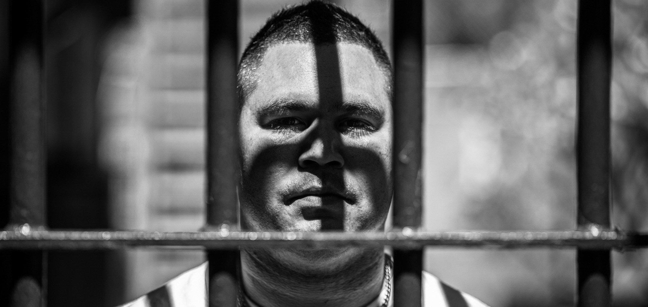 Keenan Mundine behind bars in a still from 'Incarceration Nation' (2021) (Courtesy incarcerationnation.com.au)