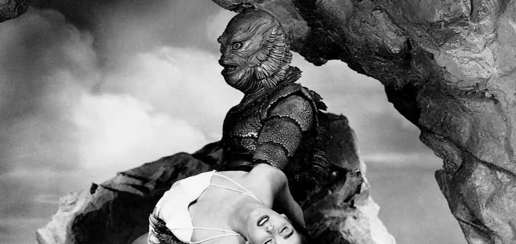 The Gill Man carries Kay in a still from 'Creature from the Black Lagoon' (1954)