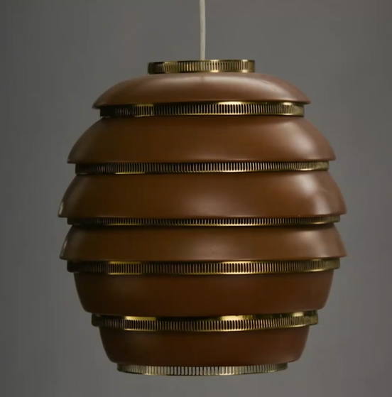 Cropped still of beehive style light fixture designed by Alvar Aalto