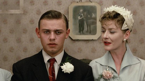 Dean Williams and Angela Walsh in a still from Distant Voices, Still Lives (1988) directed by Terence Davies