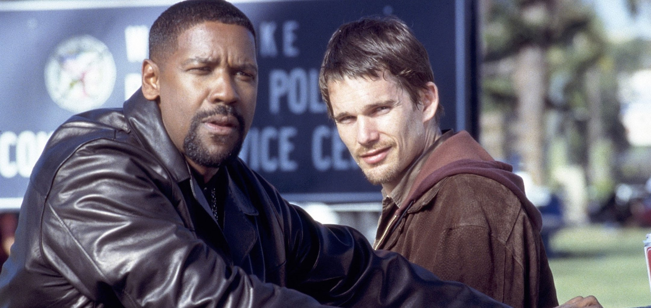 Denzel Washington and Ethan Hawke look off into the distance in a still from Training Day (2001) - Hero image