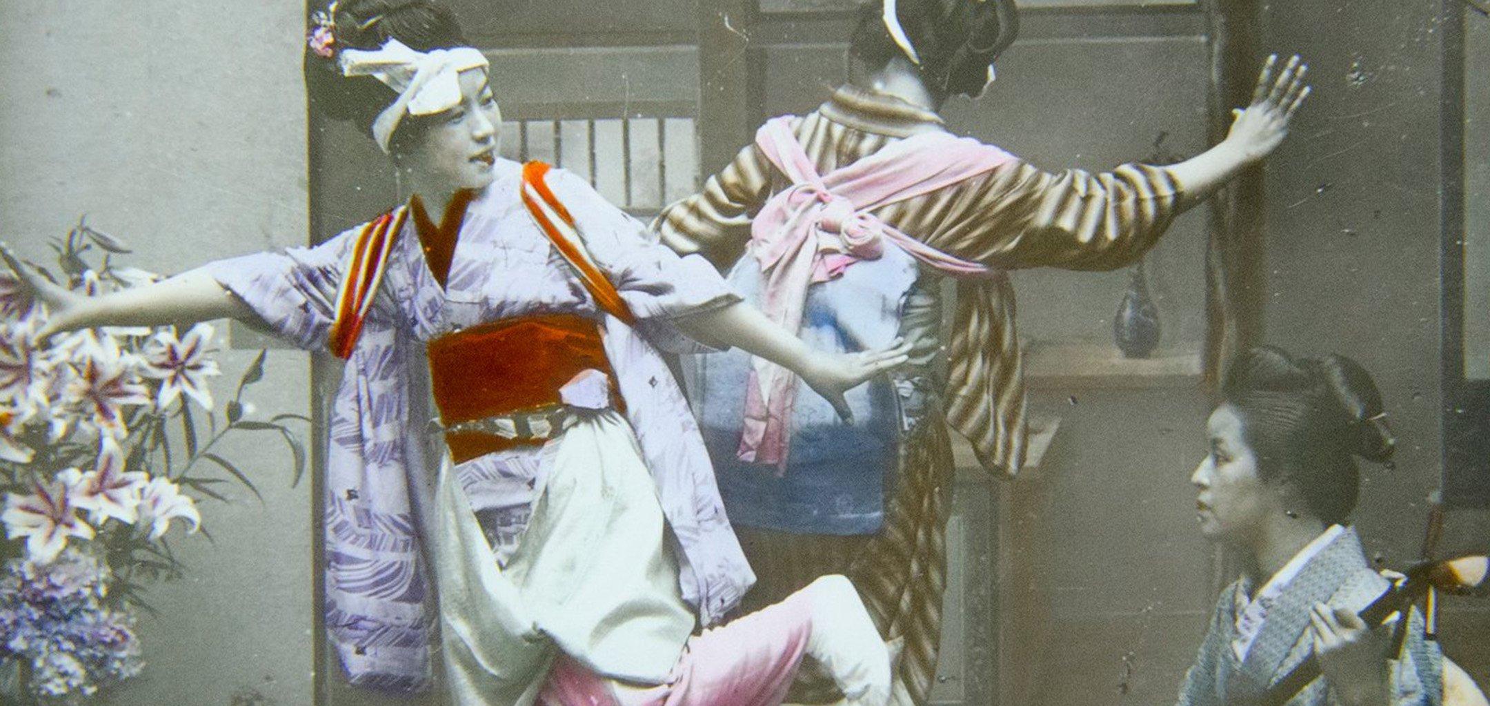 Colour magic lantern slide depicting girls dancing and a musician, Japan (detail)
