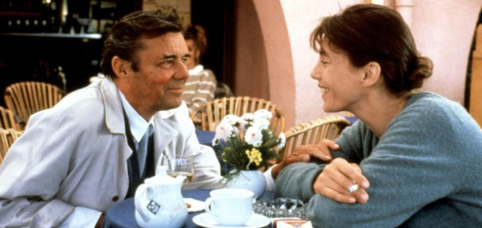 Dirk Bogarde and Jane Birkin having tea in scene from Daddy Nostalgie (1990)