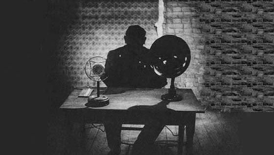Dr Mabuse in his cell writing letters.jpg