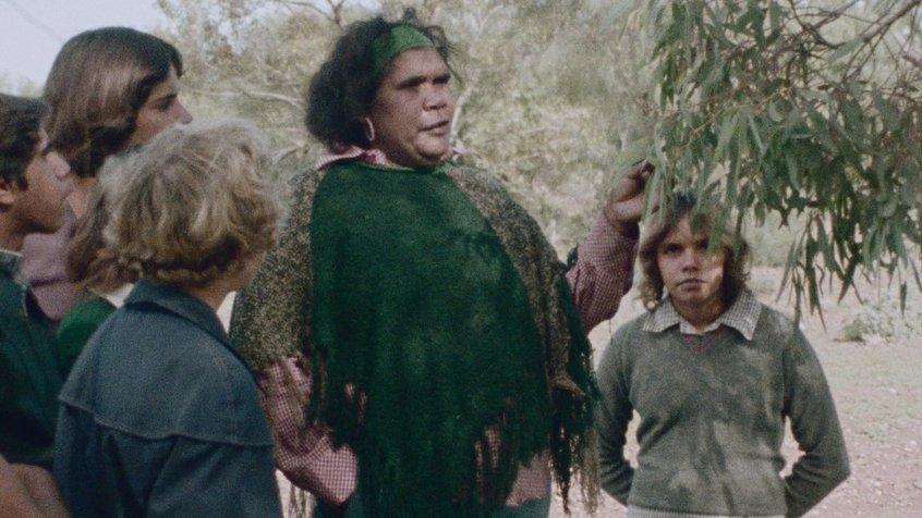 Essie Coffey teaching a group of young students outdoors in a still from 'My Survival as an Aboriginal' (1987)