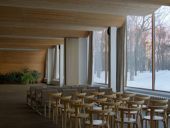 Interior of an architecturally designed hall with chairs - a still from the documentary Aalto