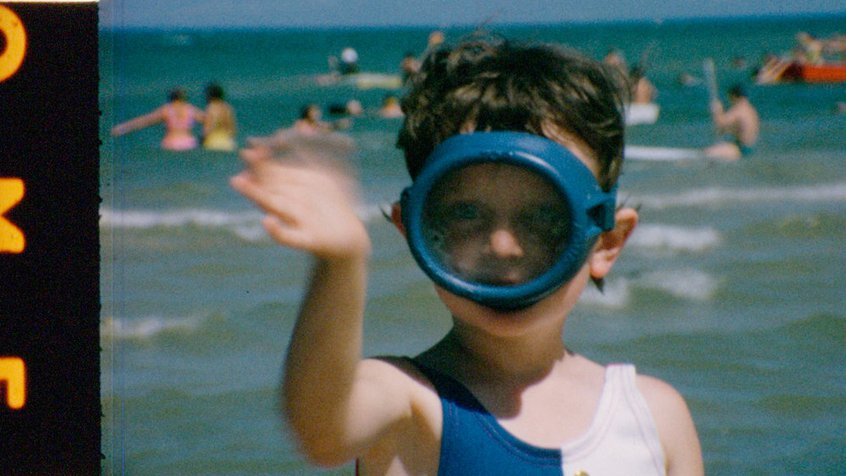Film reel from the ACMI Collection - A kid wearing a snorkel and waving.jpg