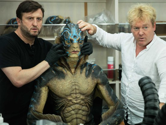 Doug Jones having prosthetics applied to his body in a behind-the-scenes still from The Shape of Water (2017)