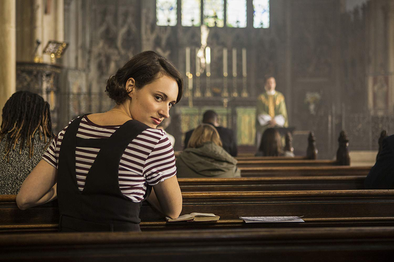 Fleabag image sitting in a church and praying.jpg