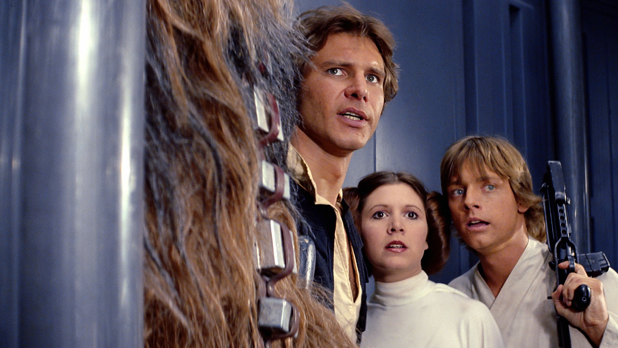 Harrison Ford, Carrie Fisher, and Mark Hamill in 'Star Wars- A New Hope' (1977)