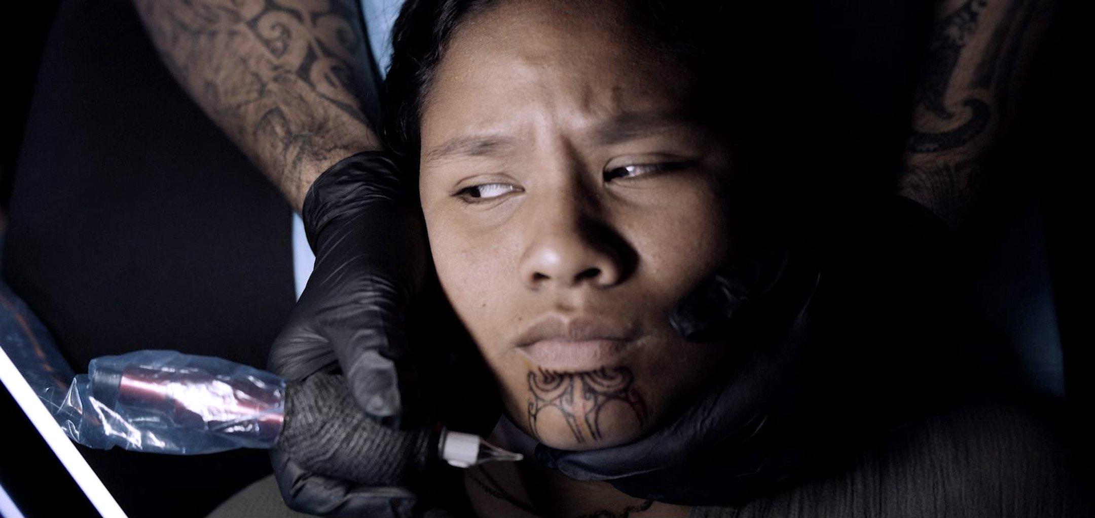 He Mangai He Korero - girl getting tattooed