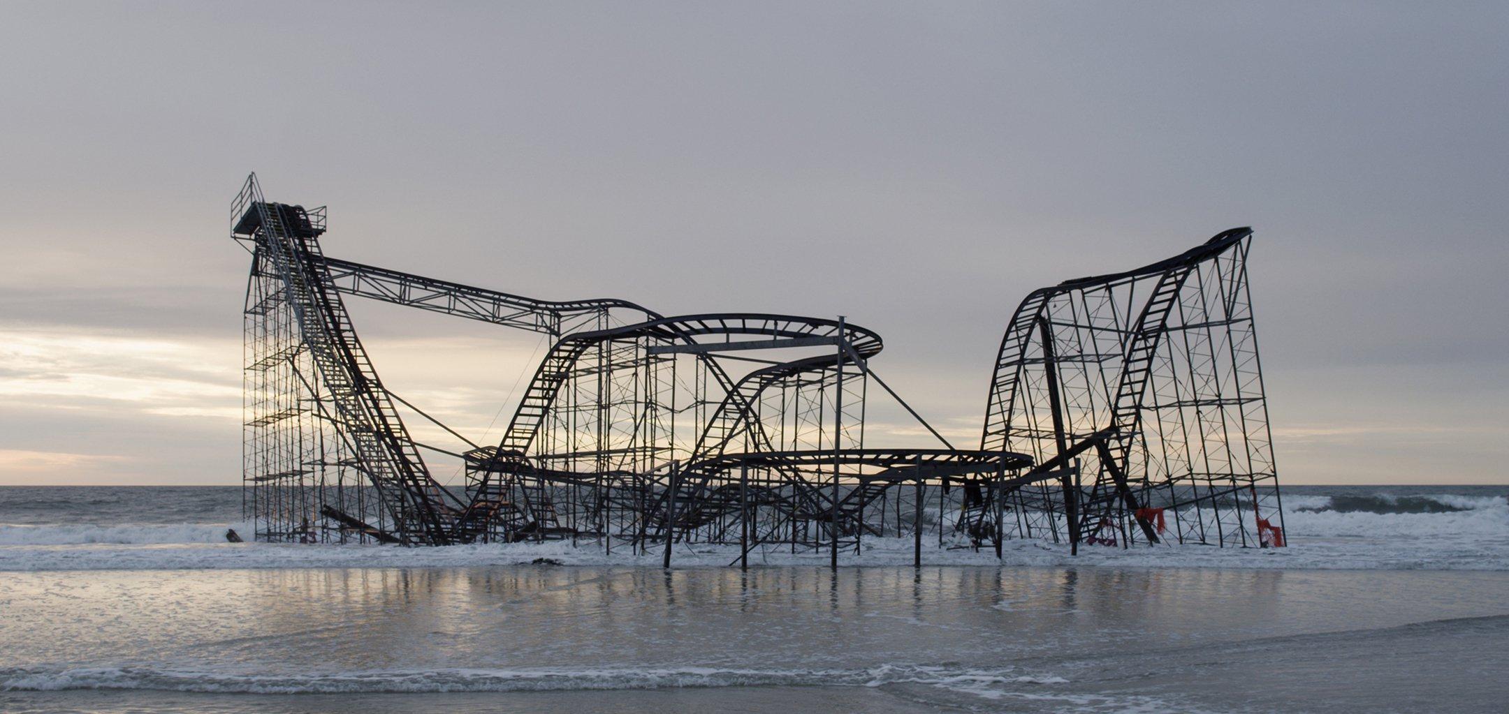 A derelict rollercoaster on a beach in a still from 'Homo Sapiens' (2016)