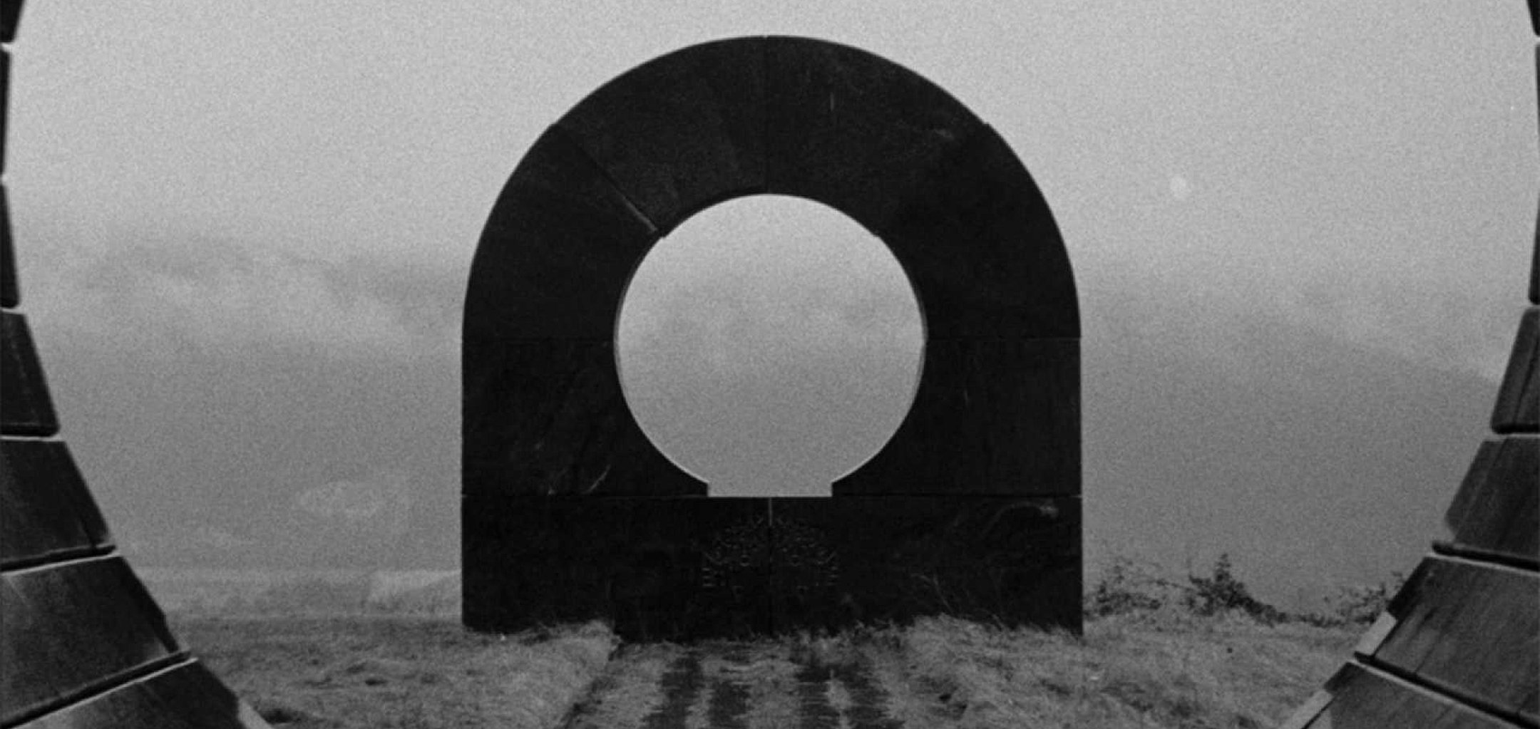 Circular arch monument in a still from 'Last and First Men' (2020)