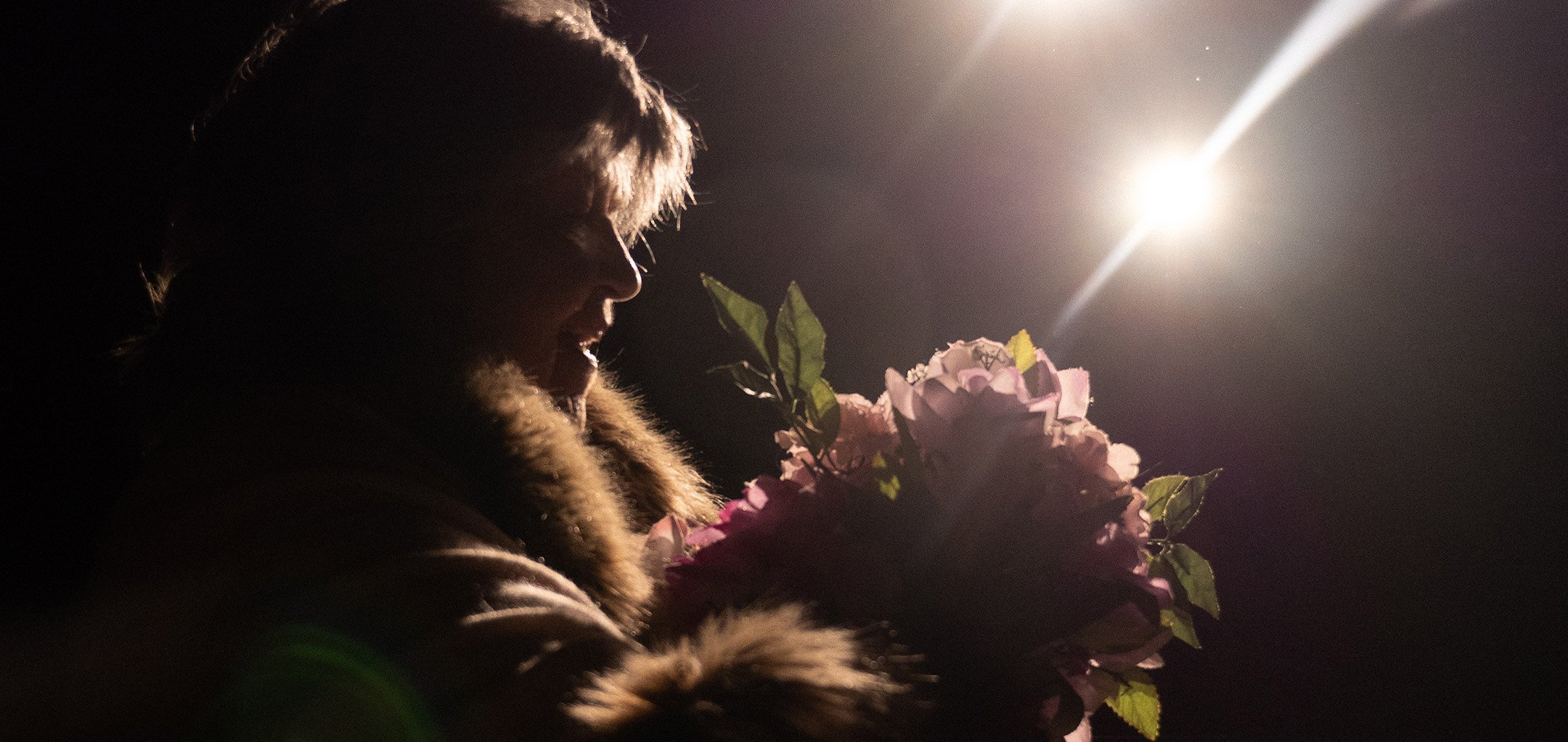A still from Laura's Choice - holding flowers