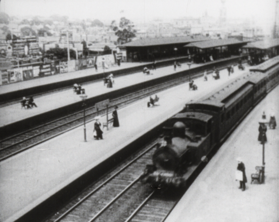 Train station - A still from Marvellous Melbourne by Charles Cozens Spencer