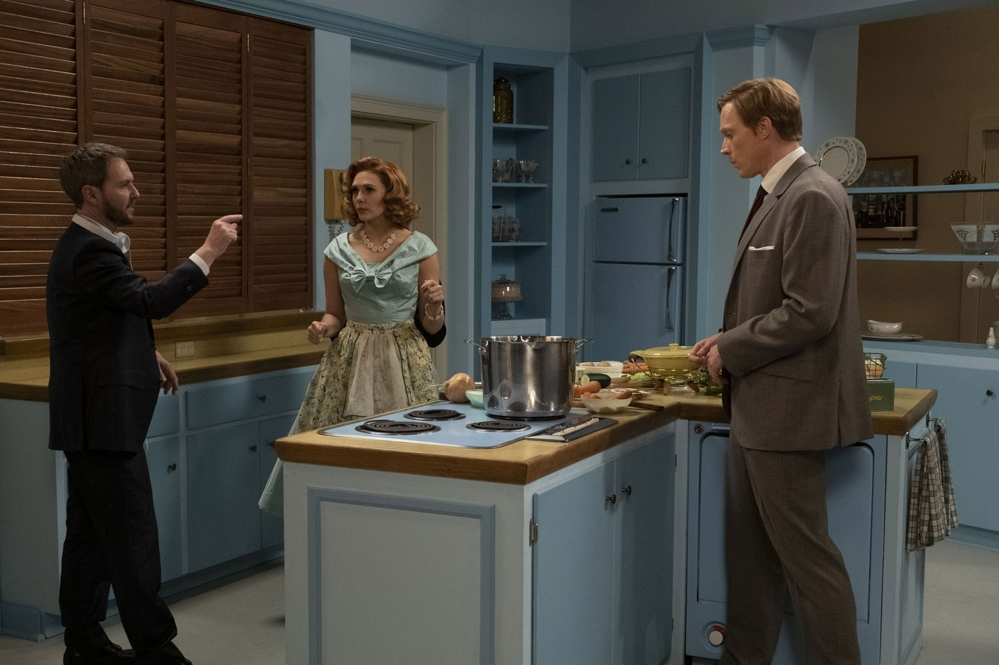 Matt Shakman, Elizabeth Olsen and Paul Bettany on a blue 1950s kitchen set - still from WandaVision (2021) .jpg