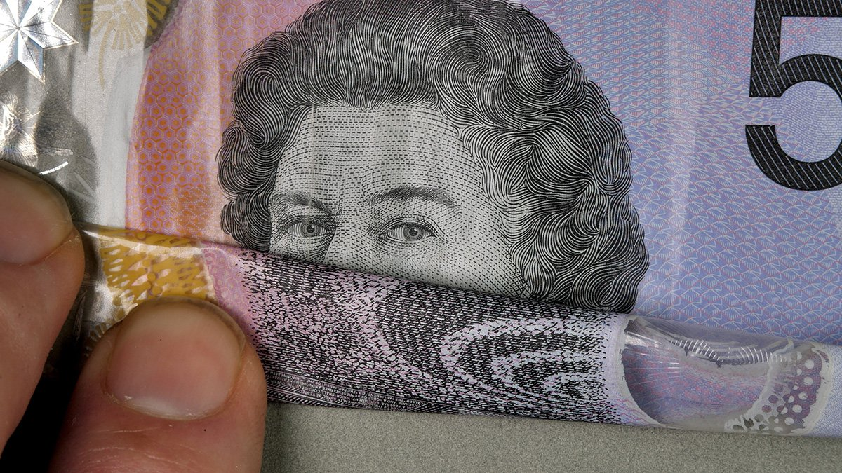Matthew Griffin - content - 5 dollar note being folded