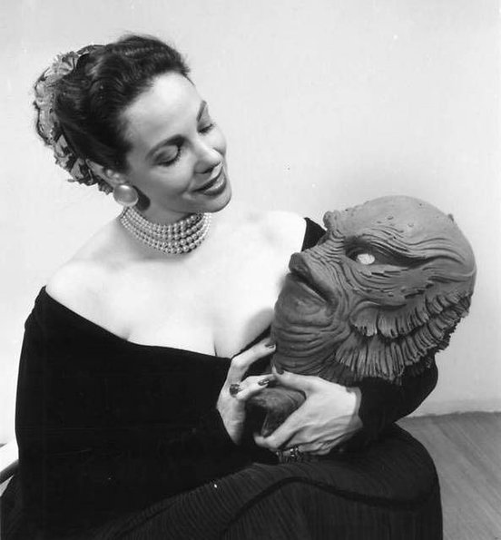 Milicent Patrick holding the creature mask she designed for the Gill Man from Creature from the Black Lagoon
