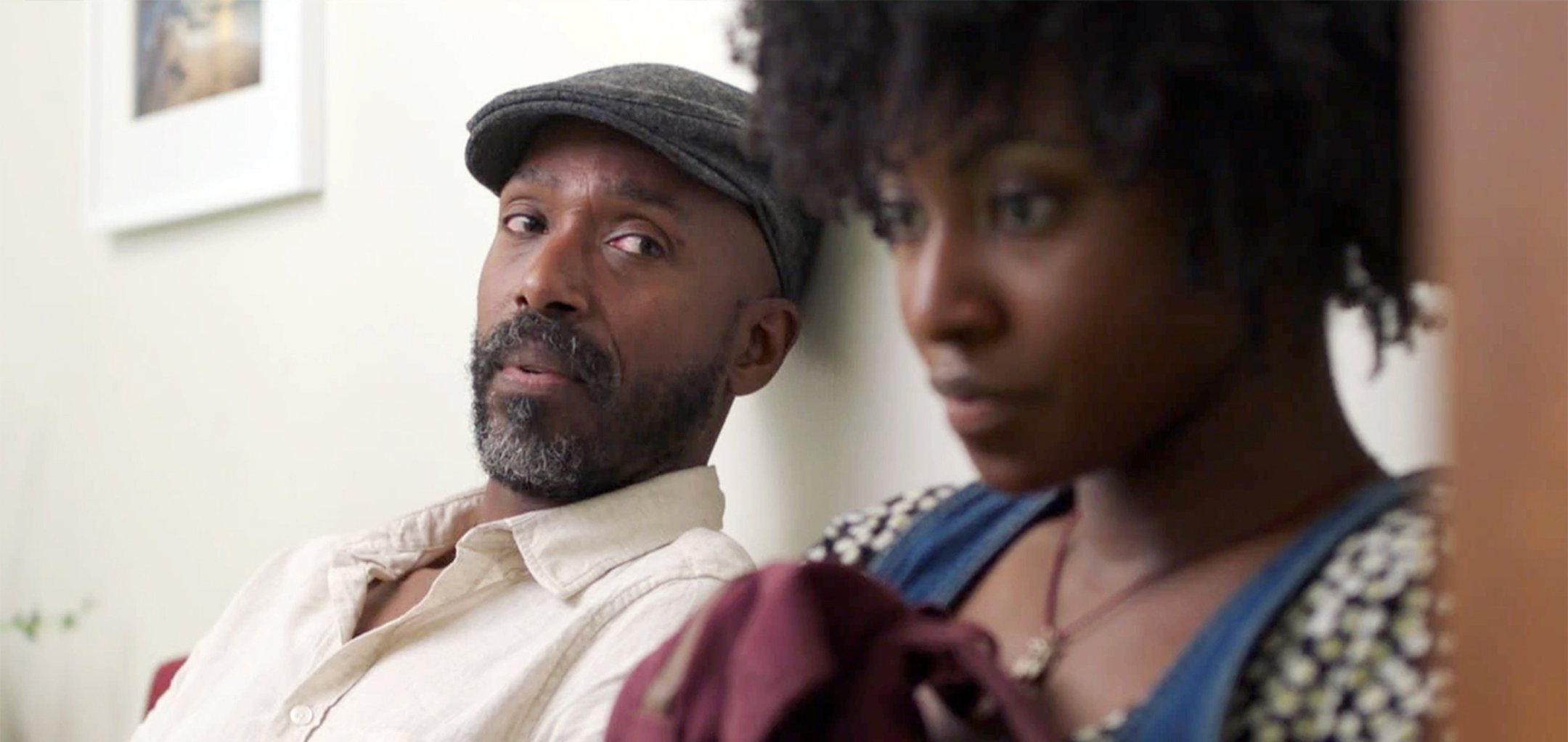 Ntare Mwine looks at Jayme Lawson in a still from Farewell Amor (2020)