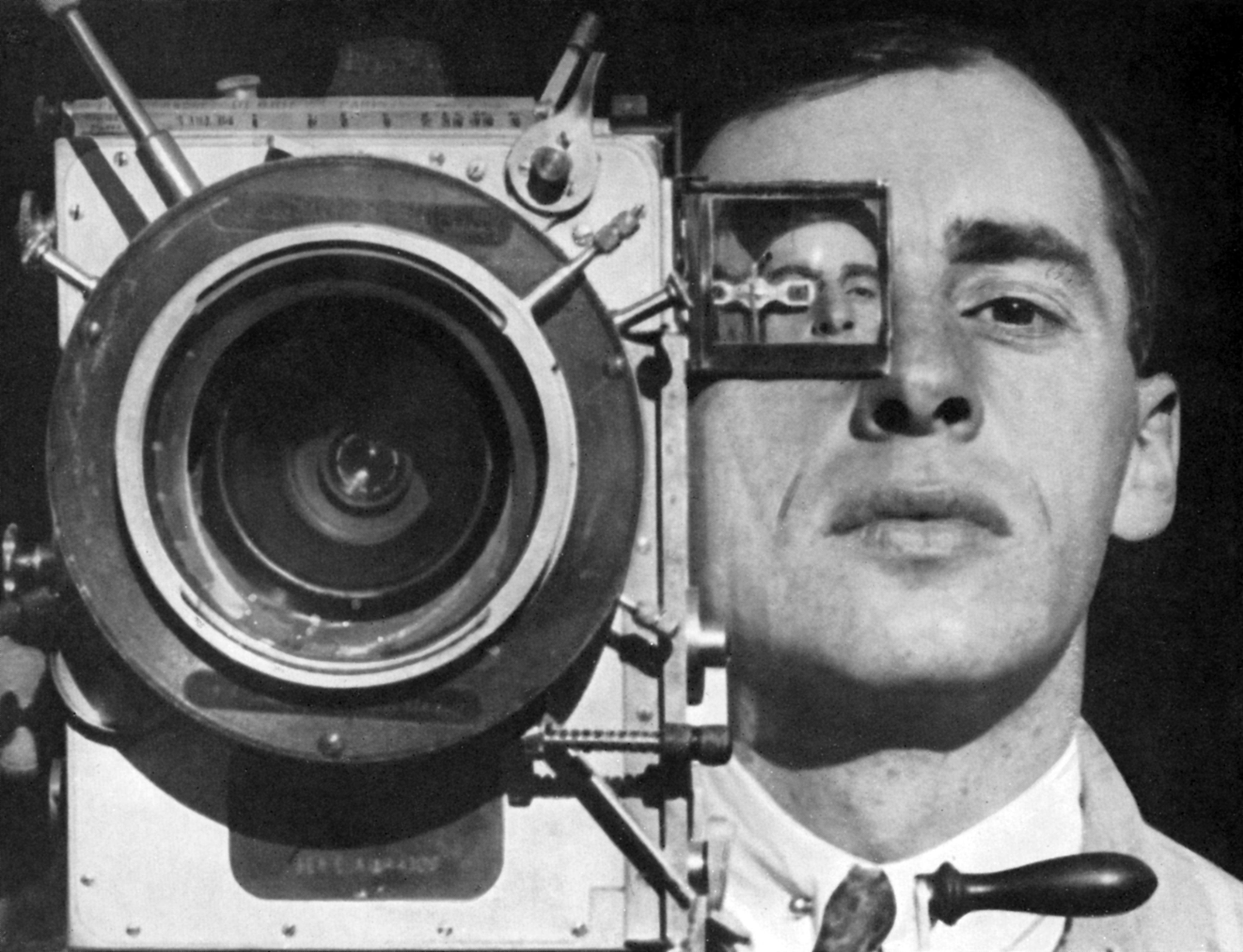 GRAPHIC: Mikhail Kaufman poses with a camera in Man with a Movie Camera, directed by Dziga Vertov (pseudonym of David Abelevich Kaufman), Russia, 1929