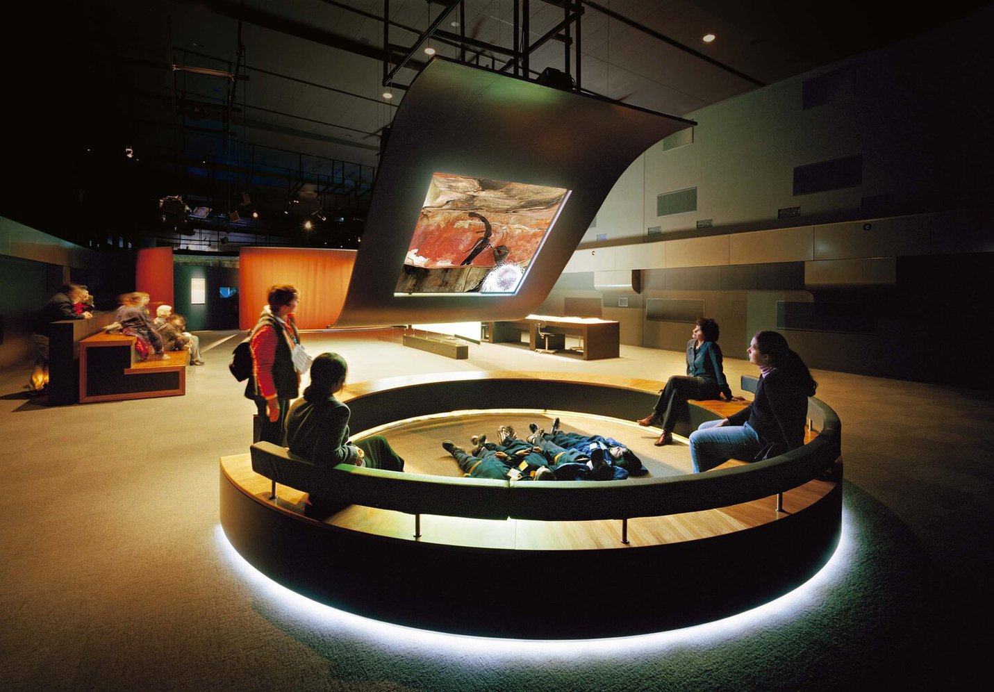 Patrons viewing a projection in Ngarinyin Pathways Dulwan.  .jpg