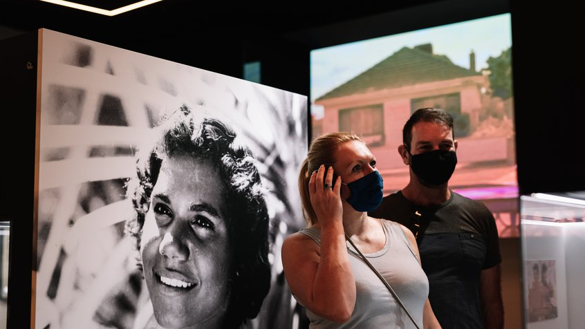 A couple listens to interactive audio in the Moving Australia section of The Story of the Moving Image (image credit: Phoebe Powell)