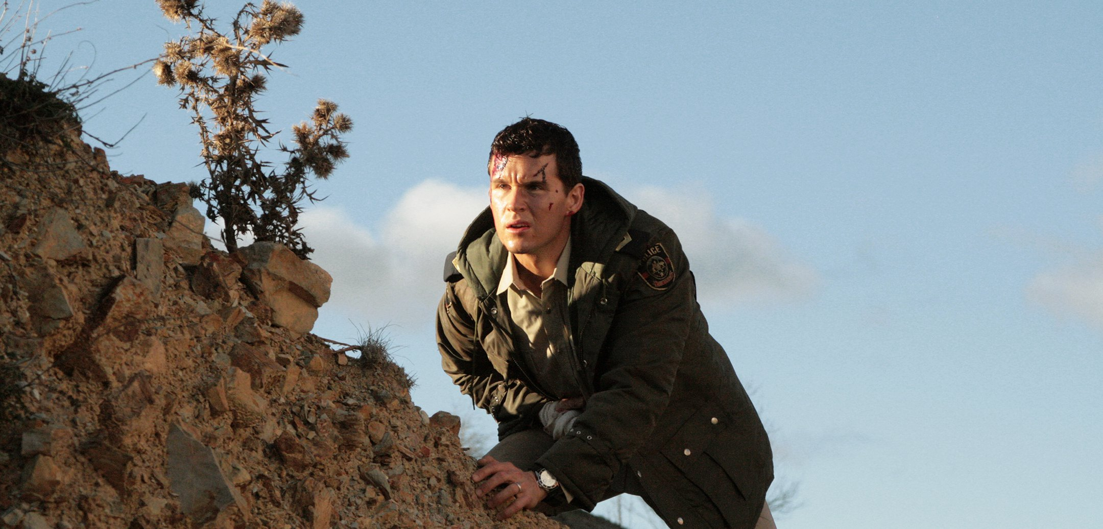 Ryan Kwanten as Shane Cooper, with head injuries ascending a hill in a still from 'Red Hill' (2010)