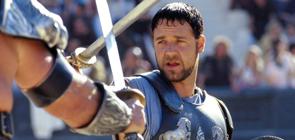 Russell Crowe fights in the colosseum in Gladiator (2000) - hero image