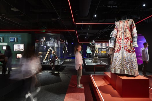 A visitor looks at The Last Emperor costumes in The Story of the Moving Image - photo by Shannon McGrath