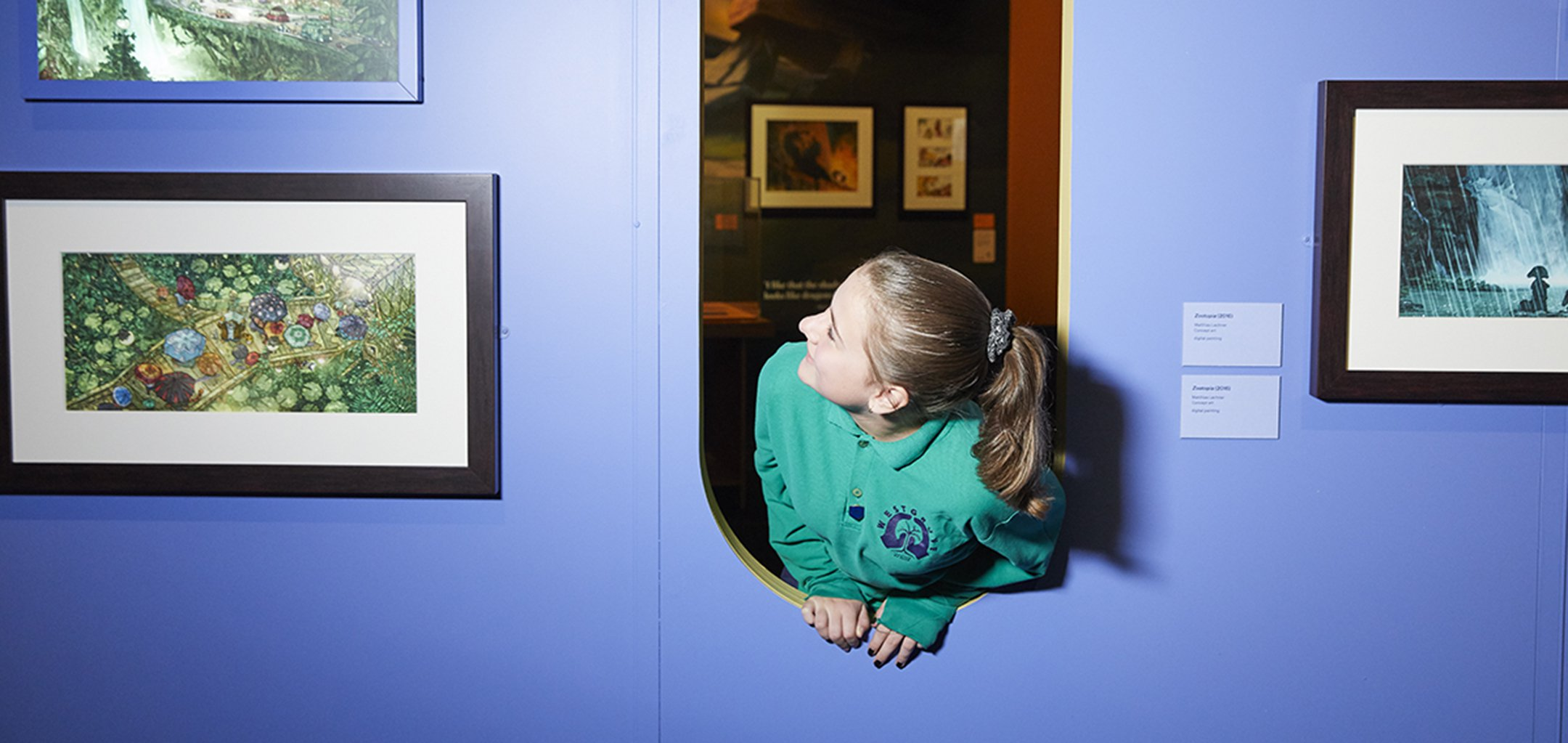 Student looking at drawings in the Disney - The Magic of Animation exhibition at ACMI