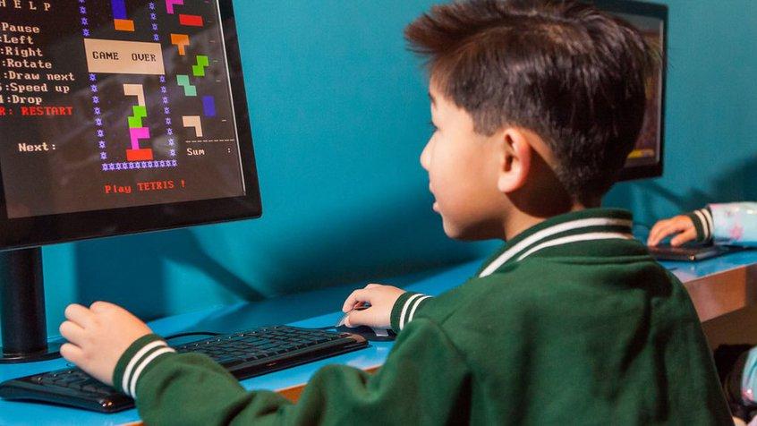 Student playing Tetris at ACMI