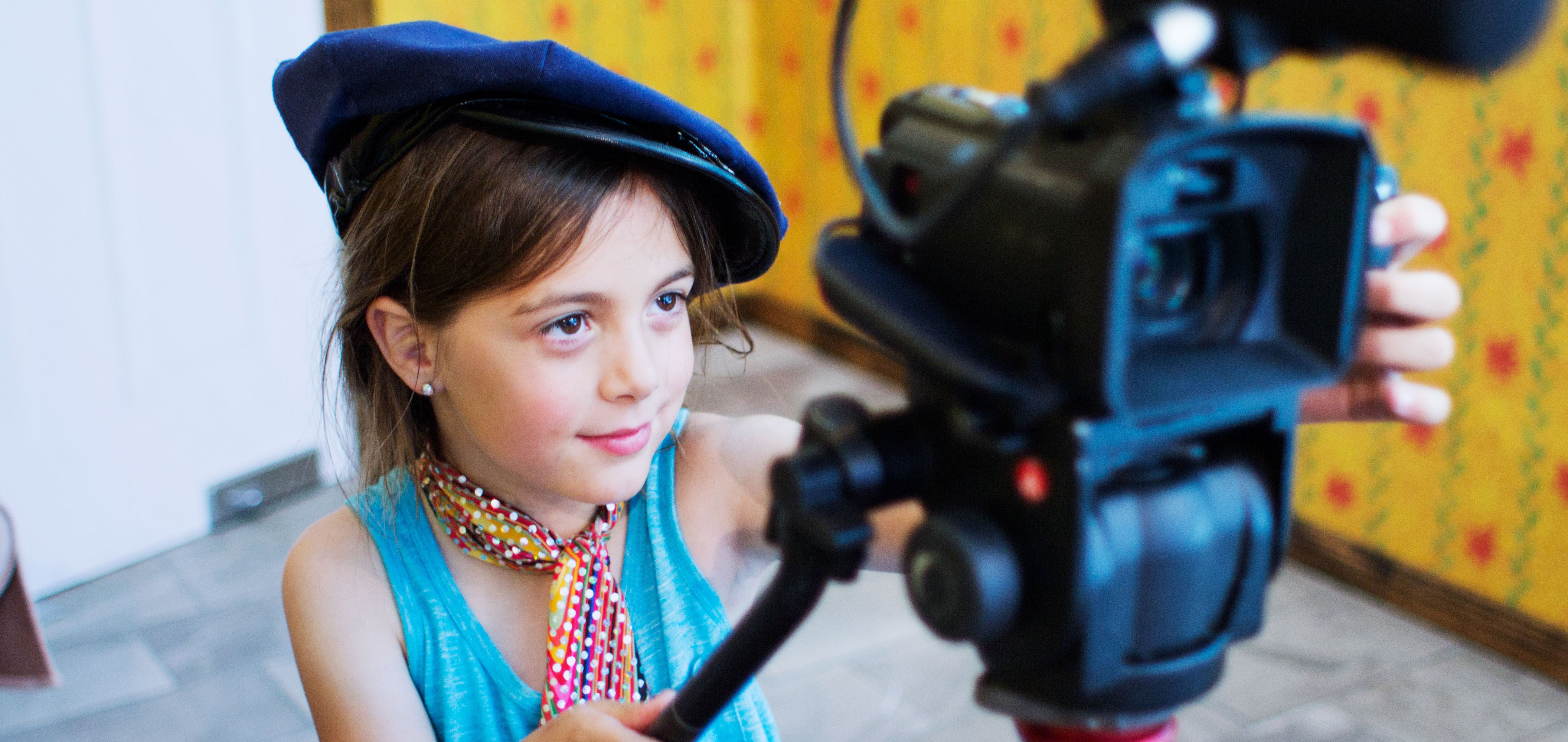 A girl using a video camera during an ACMI public program in 2019