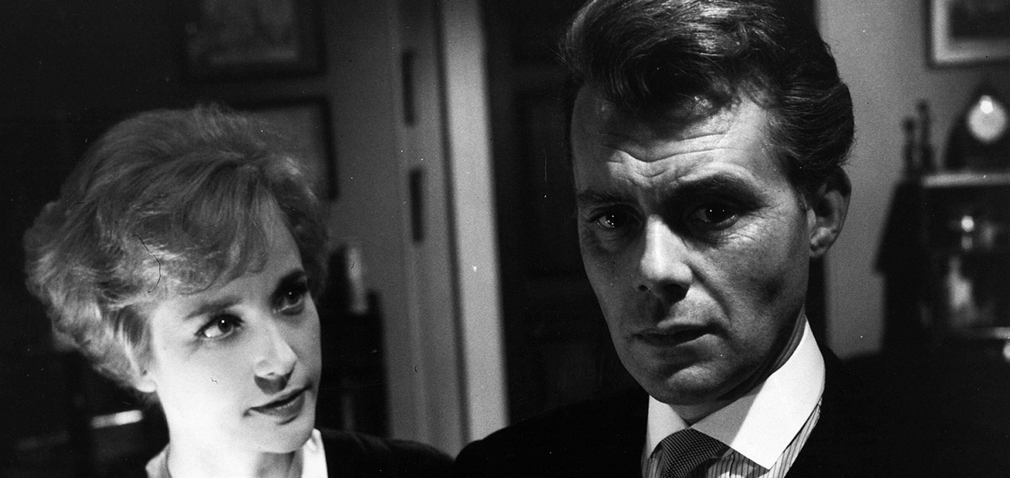 Sylvia Sims and Dirk Bogarde in a still from Victim (1961)