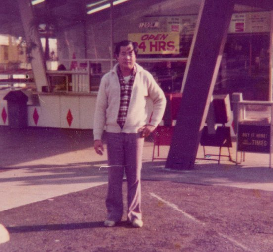 Ted Ngoy stands outside his first donut shop